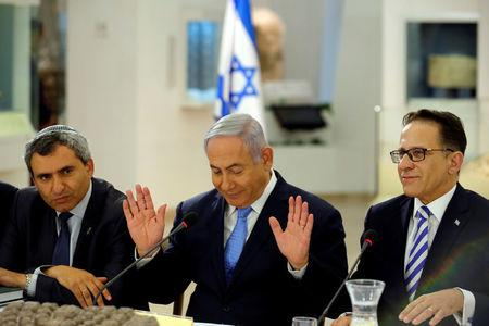 FILE PHOTO: Israeli Prime Minister Benjamin Netanyahu, Minister of Jerusalem and Environmental Protection Zeev Elkin and Cabinet Secretary Tzachi Braverman attend a special cabinet meeting marking Jerusalem Day, at the Bible Lands Museum in Jerusalem