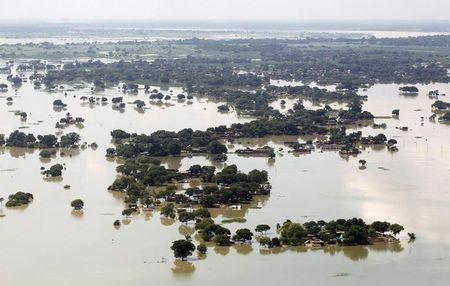 An aerial view of a flooded village on the outskirts of Allahabad, India. REUTERS/Jitendra Prakash