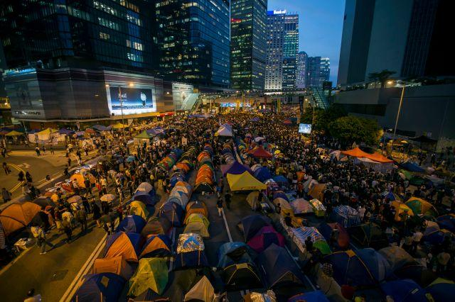 Protesters and tents occupy the main road to the financial Central district during the one month anniversary of the Occupy Central civil disobedience movement, in Hong Kong October 28, 2014.