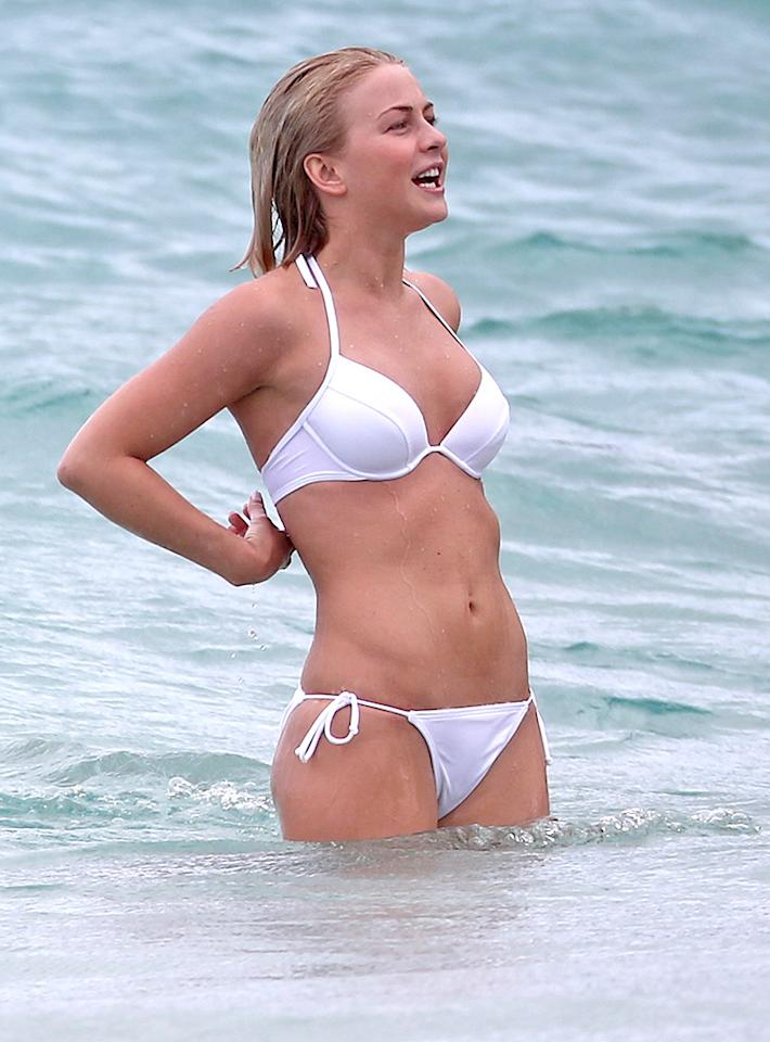"<p class=""MsoNormal"">Washboard abs, check. White hot bikini, check! Julianne Hough's overall St. Barths vacay look? Perfection. (1/4/13)</p>"