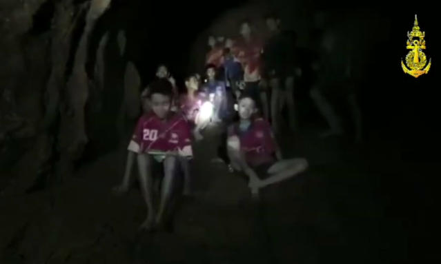 <p>In this screengrab from video, the boys and their soccer coach are shown after they were found in a cave in Chiang Rai, Thailand, on July 2, 2018. Rescuers found all 12 boys and their soccer coach alive deep inside a partially flooded cave in northern Thailand, more than a week after they disappeared and touched off a desperate search that drew international help and captivated the world. (Photo: Thai Navy SEAL via AP) </p>