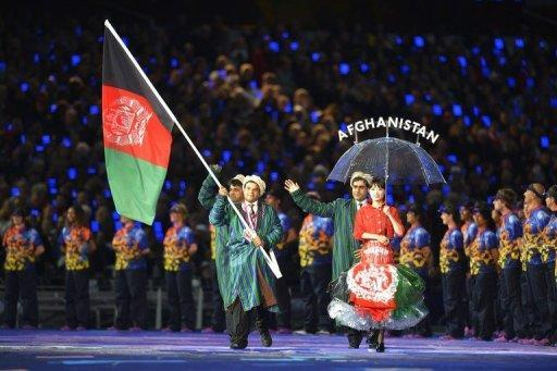 Members of Afghanistan's delegation parade during the opening ceremony of the London 2012 Paralympic Games at the Olympic Stadium. Queen Elizabeth II on Wednesday officially opened the London Paralympics, at a showpiece ceremony aimed at challenging perceptions about disability and celebrating the triumph of the human spirit