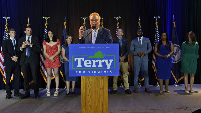 Winner of the Virginia Democratic gubernatorial primary, former Virginia Gov. Terry McAuliffe, center, addresses the crowd during an election party in McLean, Va., Tuesday, June 8, 2021. McAuliffe faced four other Democrats in Tuesday's primary. (AP Photo/Steve Helber)