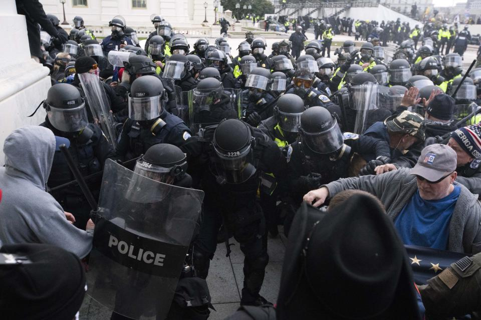 U.S. Capitol Police push back demonstrators who are trying to enter the U.S. Capitol on Wednesday, Jan. 6, 2021, in Washington. (AP Photo/Jose Luis Magana)