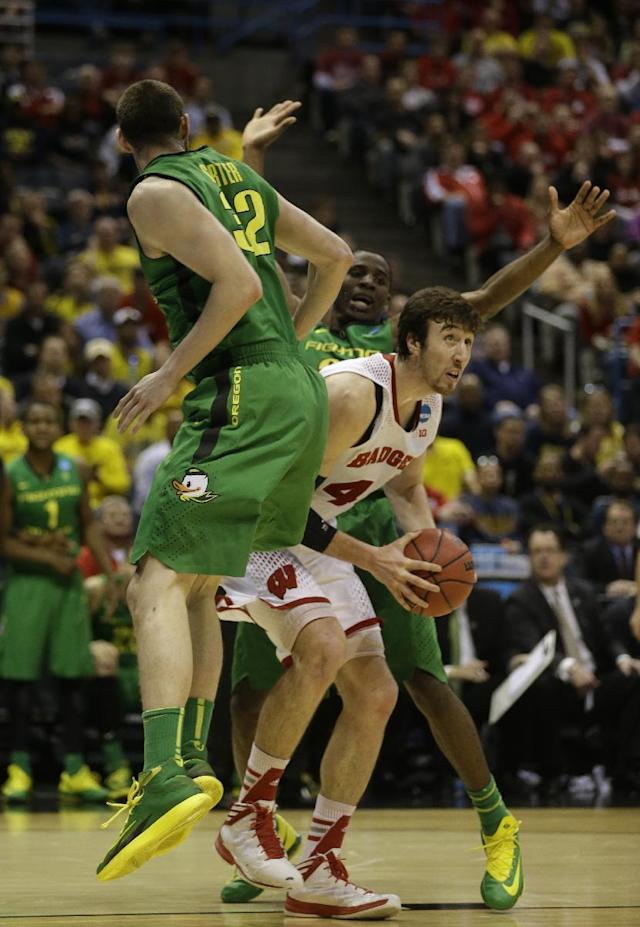 Wisconsin forward Frank Kaminsky (44) drives to the basket against Oregon- defense during the first half of a third-round game of the NCAA college basketball tournament Saturday, March 22, 2014, in Milwaukee. (AP Photo/Jeffrey Phelps)