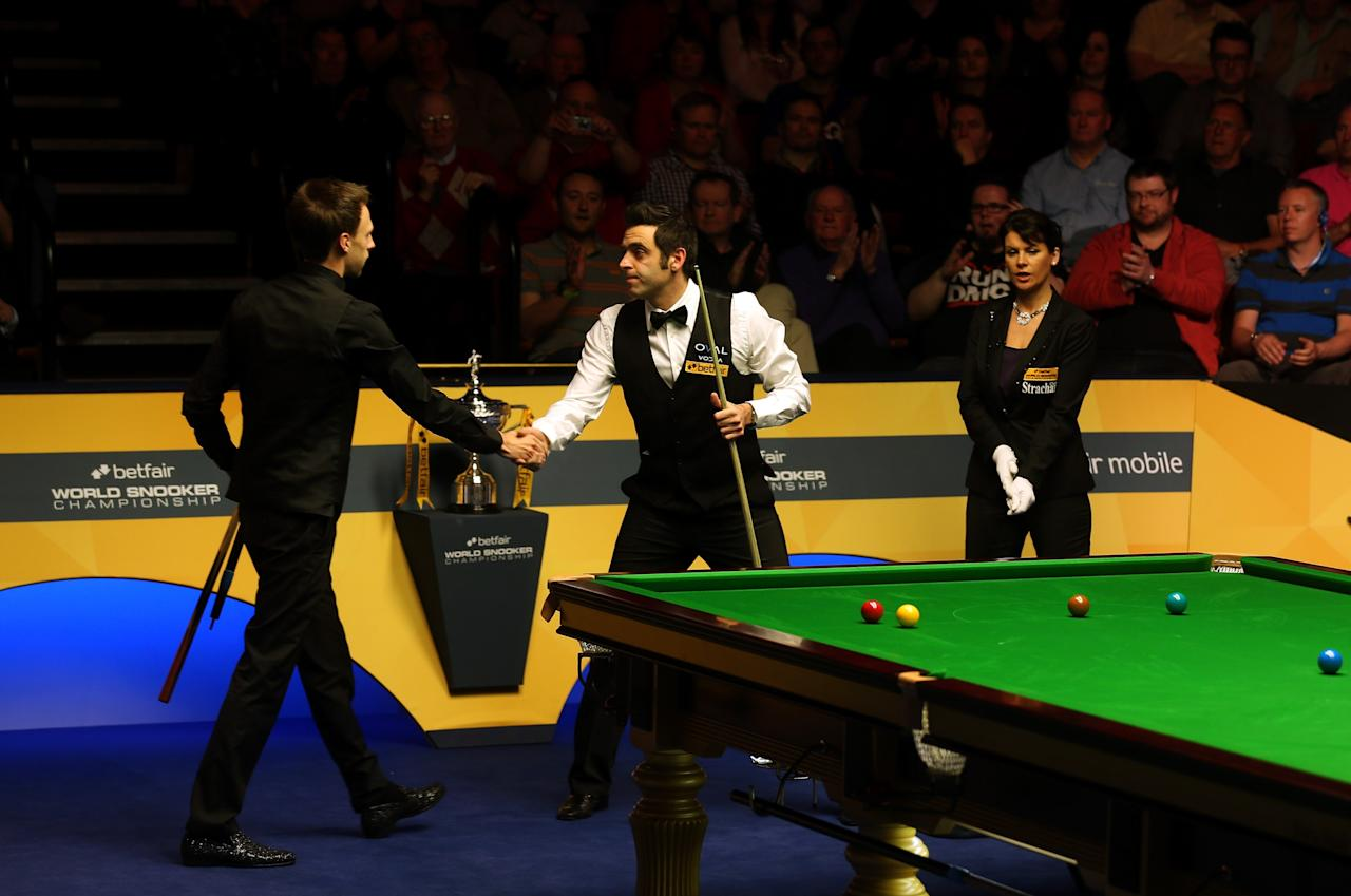 SHEFFIELD, ENGLAND - MAY 04:  Ronnie O'Sullivan of England is congratulated by Judd Trump of England after winning the Semi Final match of the Betfair World Snooker Championship at the Crucible Theatre on May 4, 2013 in Sheffield, England.  (Photo by Warren Little/Getty Images)