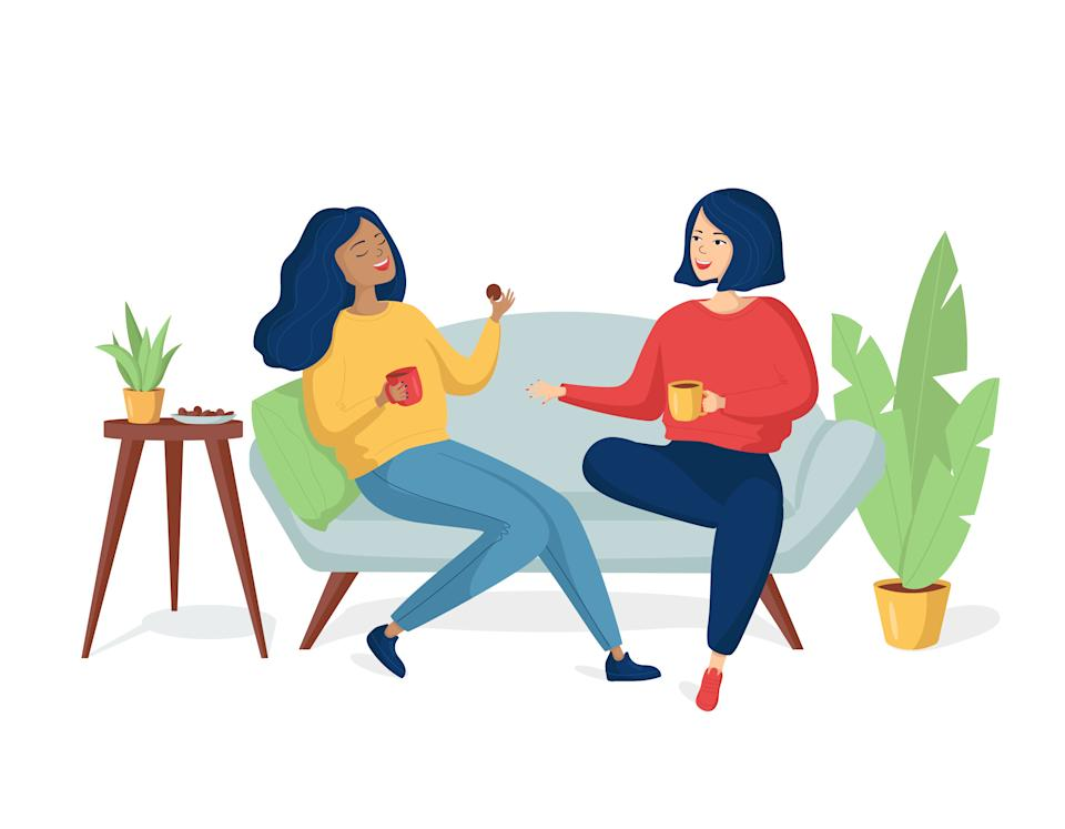 Two young happy cheerful women are sitting on the couch and laughing. Girlfriends drink tea with cookies. A same-sex family spends time together.Two sisters are talking and smiling.Multicolored Vector illustration