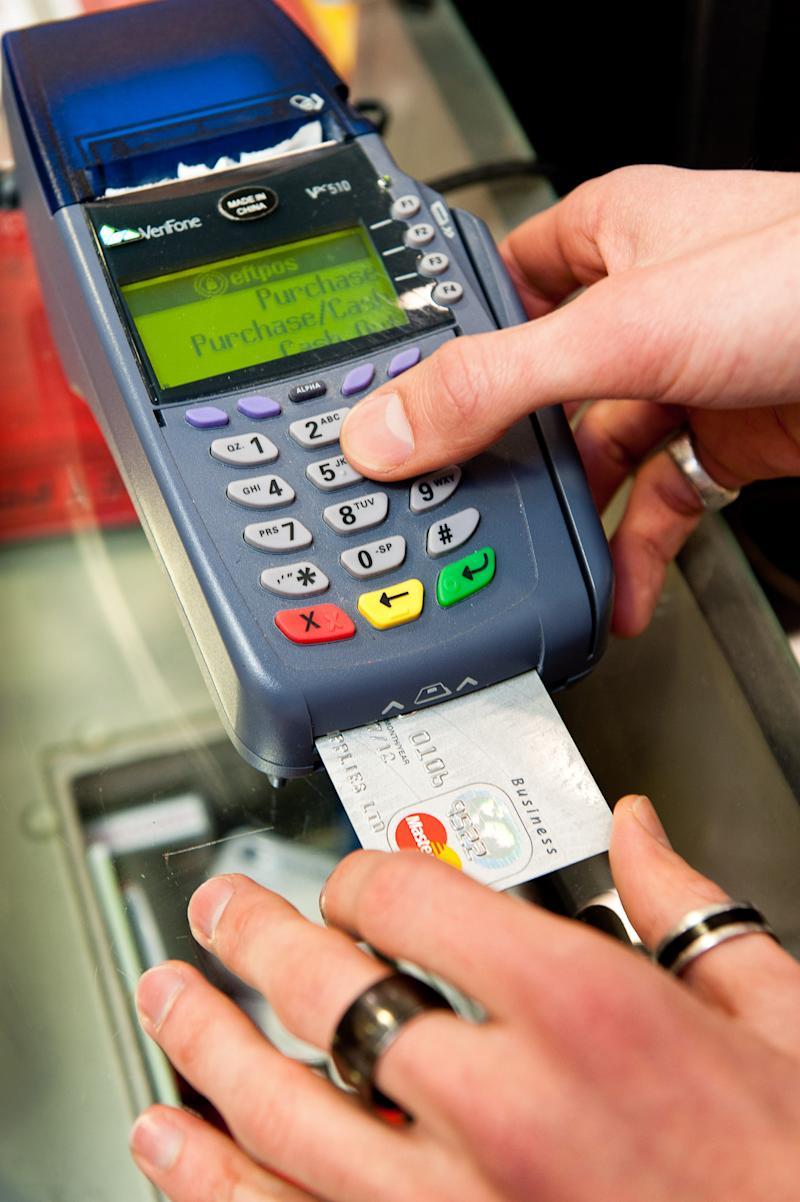 Eftpos machine and bank card being inserted at Coles switches processing away from Visa.