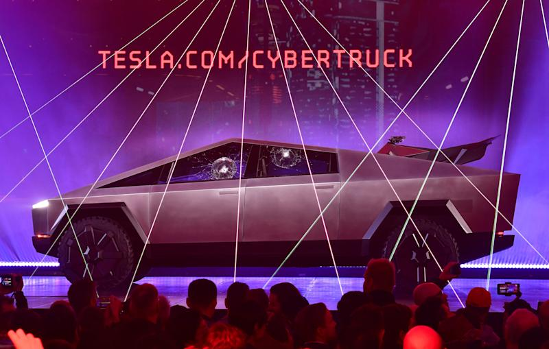 People take pictures of the newly unveiled all-electric battery-powered Tesla's Cybertruck with shattered windows after a failed resistance test, at Tesla Design Center in Hawthorne, California on November 21, 2019. (Photo by FREDERIC J. BROWN / AFP) (Photo by FREDERIC J. BROWN/AFP via Getty Images)