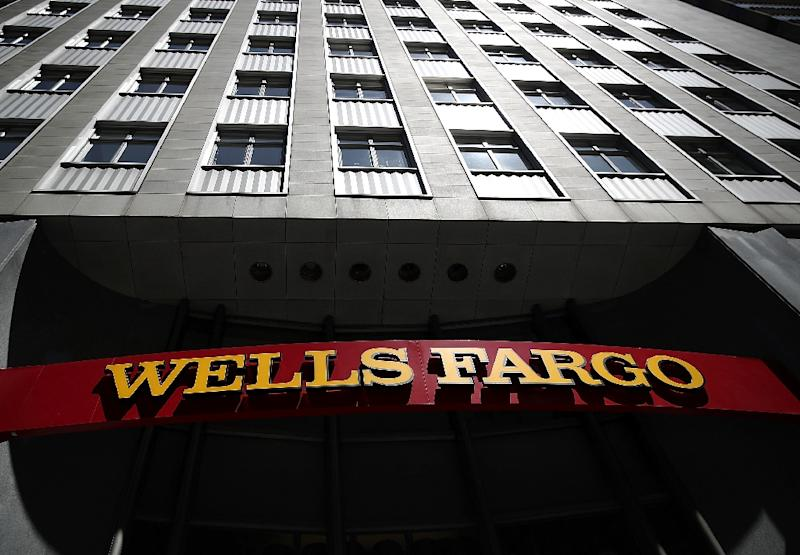 At Wells Fargo, net income came in at $6.2 billion, up 17 percent from the year-ago period and lifted by $3.4 billion in one-time items connected to the accounting of its future tax liability (AFP Photo/JUSTIN SULLIVAN)