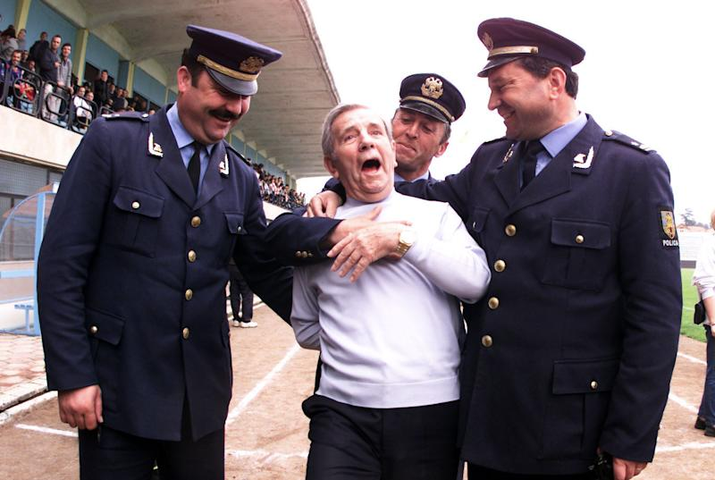 Norman Wisdom entertains the local police while England train in Albania, 2001 (Andy Hooper/Daily Mail/REX/Shutterstock)