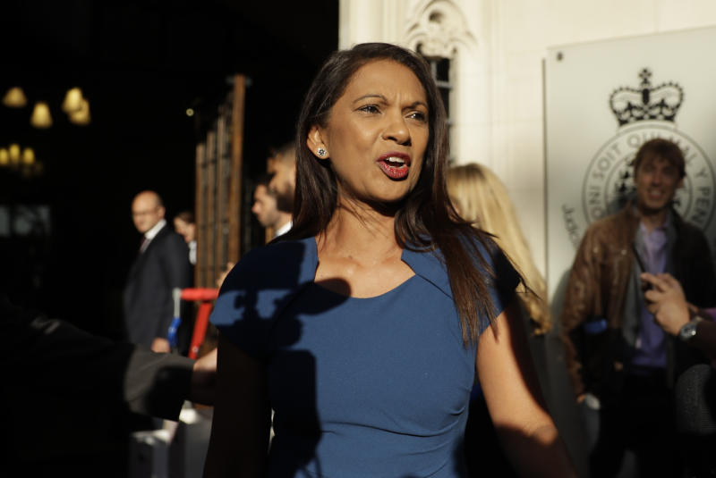 Anti Brexit campaigner Gina Miller arrives at the Supreme Court in London, Tuesday Sept. 17, 2019. The Supreme Court is set to decide whether Prime Minister Boris Johnson broke the law when he suspended Parliament on Sept. 9, sending lawmakers home until Oct. 14 — just over two weeks before the U.K. is due to leave the European Union. (AP Photo/Matt Dunham)