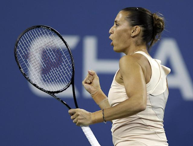 Flavia Pennetta, of Italy, reacts after breaking the serve of Serena Williams, of the United States, during the quarterfinals of the U.S. Open tennis tournament Wednesday, Sept. 3, 2014, in New York. (AP Photo/Darron Cummings)