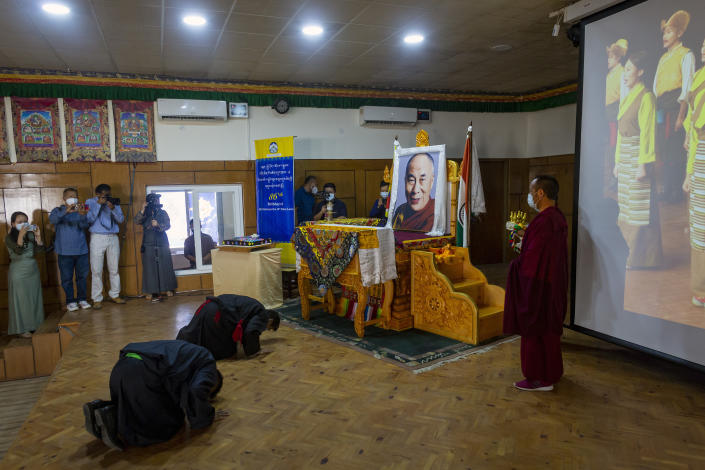 President of the Central Tibetan Administration Penpa Tsering, front corner, prostrates in front of a portrait of Tibetan spiritual leader the Dalai Lama during a ceremony to mark the 86th birthday of his leader in Dharmsala, India, Tuesday, July 6, 2021. (AP Photo/Ashwini Bhatia)