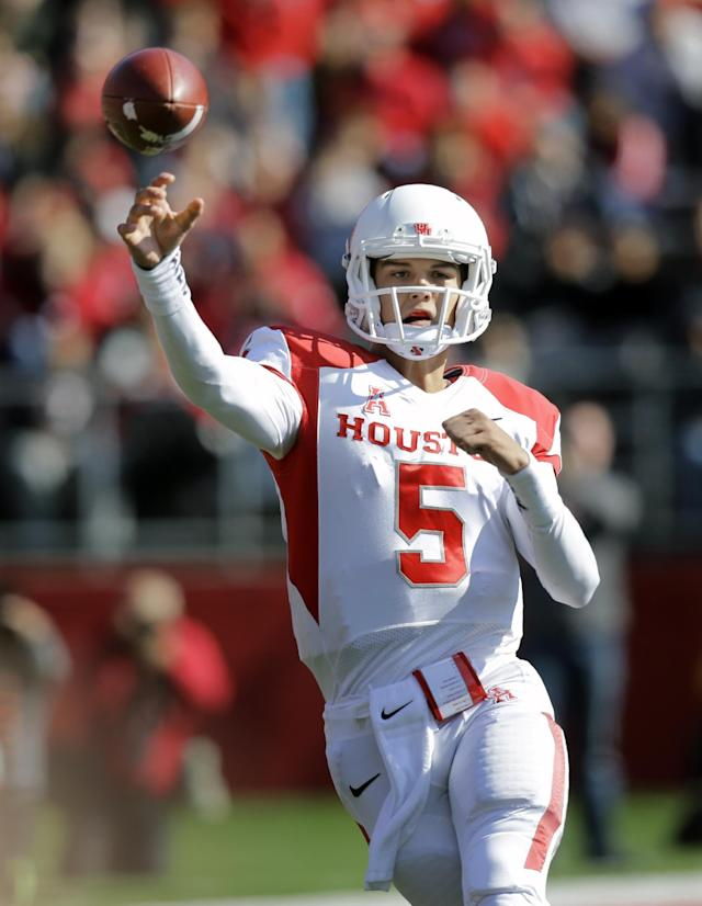 Houston quarterback John O' Korn (5) throws a pass during the first half of an NCAA college football game against Rutgers, Saturday, Oct. 26, 2013, in Piscataway, N.J. (AP Photo/Mel Evans)