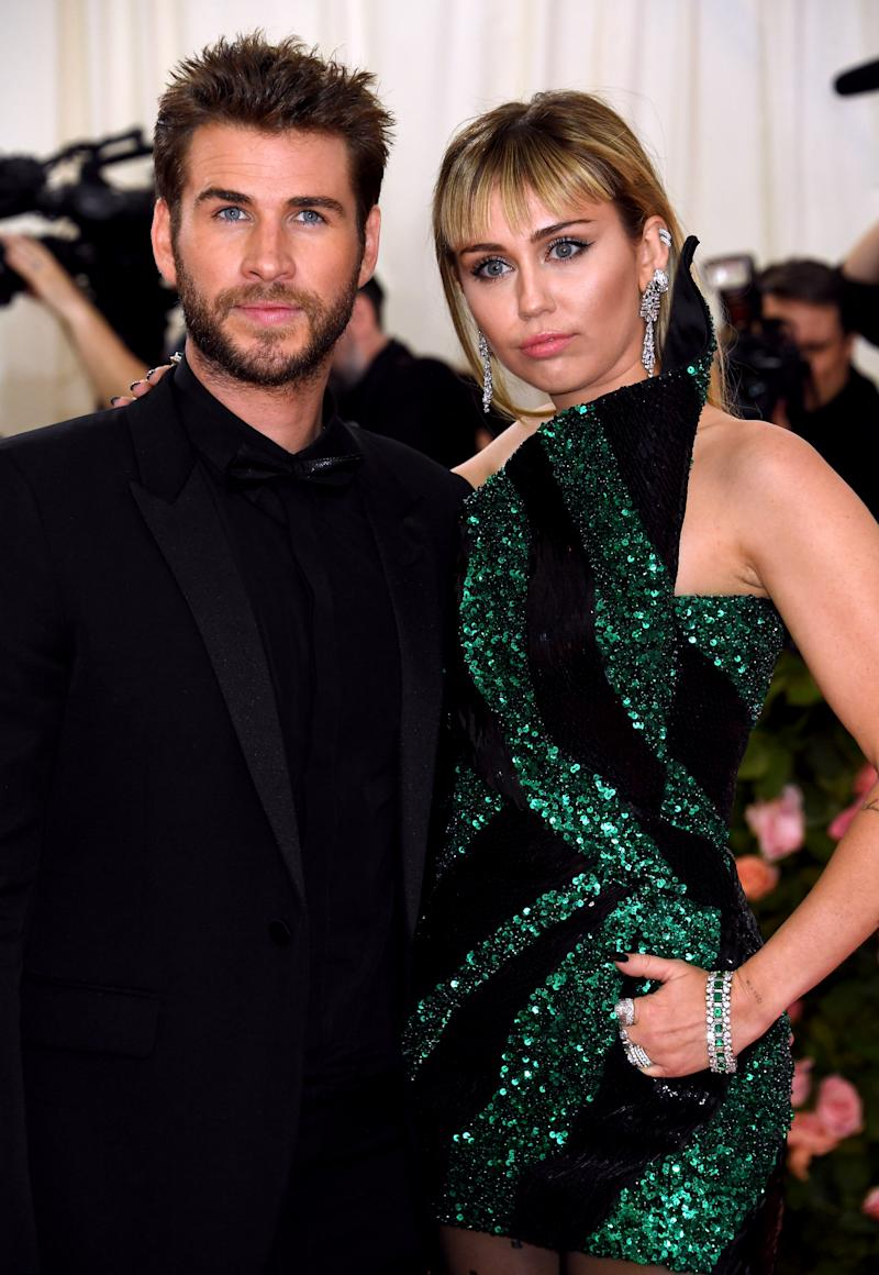 Miley Cyrus and Liam Hemsworth not smiling