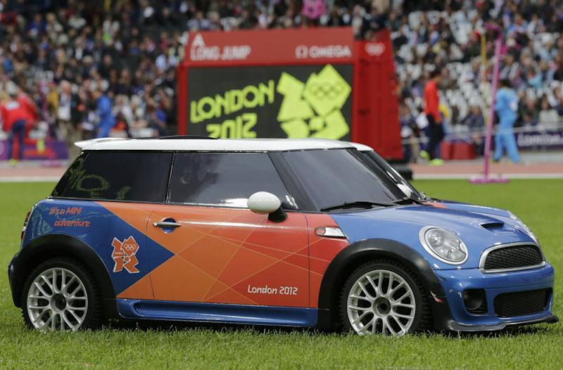 Remote controlled Mini cars sit on the field prior to the start of the athletics competitions in the Olympic Stadium at the 2012 Summer Olympics, London, Tuesday, Aug. 7, 2012. The cars are used to transport equipment on the pitch. (AP Photo/David J. Phillip )