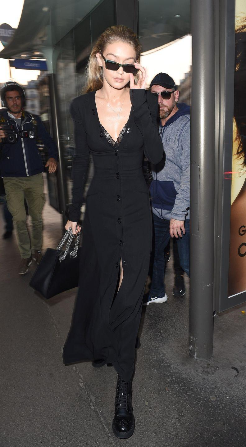 <p>In a black buttoned dress with Prada boots and Andy Wolf sunglasses while out in Paris. </p>