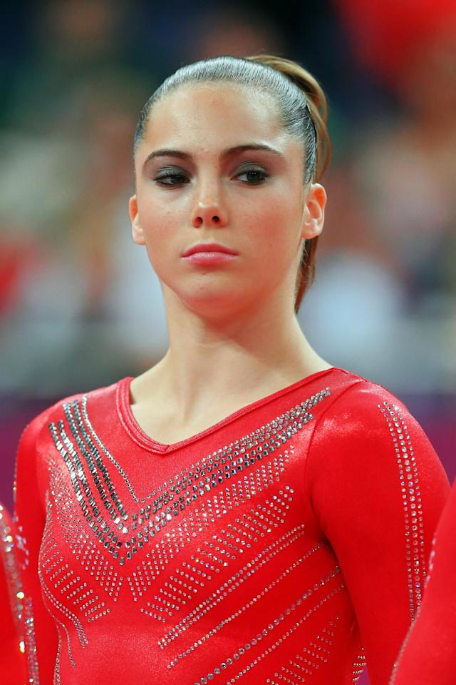 <p>McKayla Maroney Maroney of the United States looks on as she is introduced in the Artistic Gymnastics Women's Team final on Day 4 of the London 2012 Olympic Games at North Greenwich Arena on July 31, 2012 in London, England. (Photo by Ronald Martinez/Getty Images) </p>