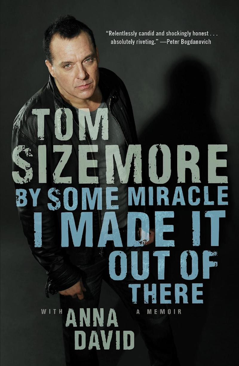 """This book cover image released by Atria shows """"By Some Miracle I Made it Out of There,"""" a memoir by Tom Sizemore with Anna David. (AP Photo/Atria)"""