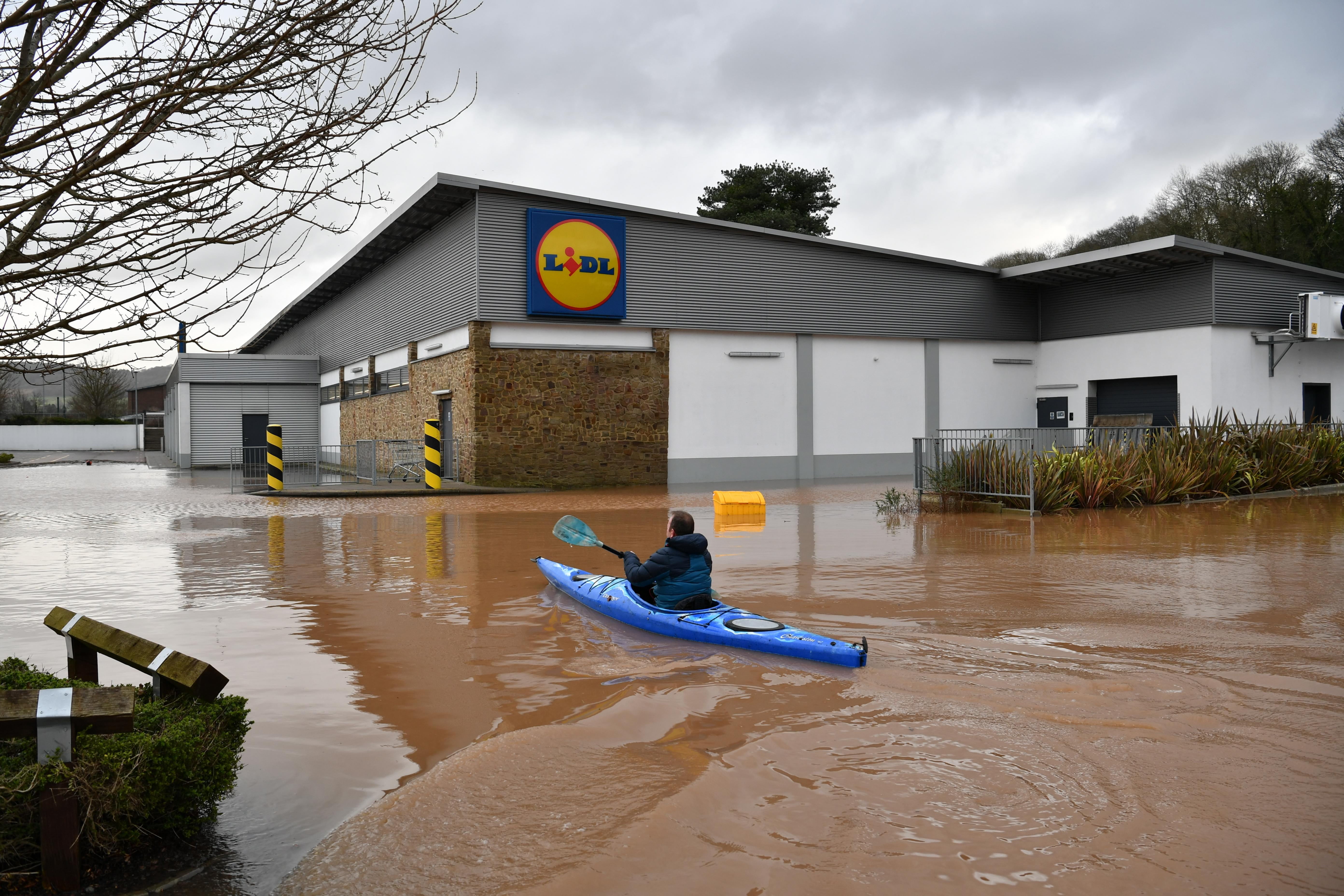 A canoeist makes their way towards Lidl in Monmouth, in the aftermath of Storm Dennis. (Photo by Ben Birchall/PA Images via Getty Images)