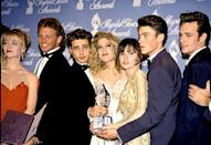 Jenni Garth, Ian Ziering, Jason Priestley, Tori Spelling, Shannen Doherty, Brian Austin Green, and Luke Perry in the press room at the 1992 People's Choice Awards in Hollywood.