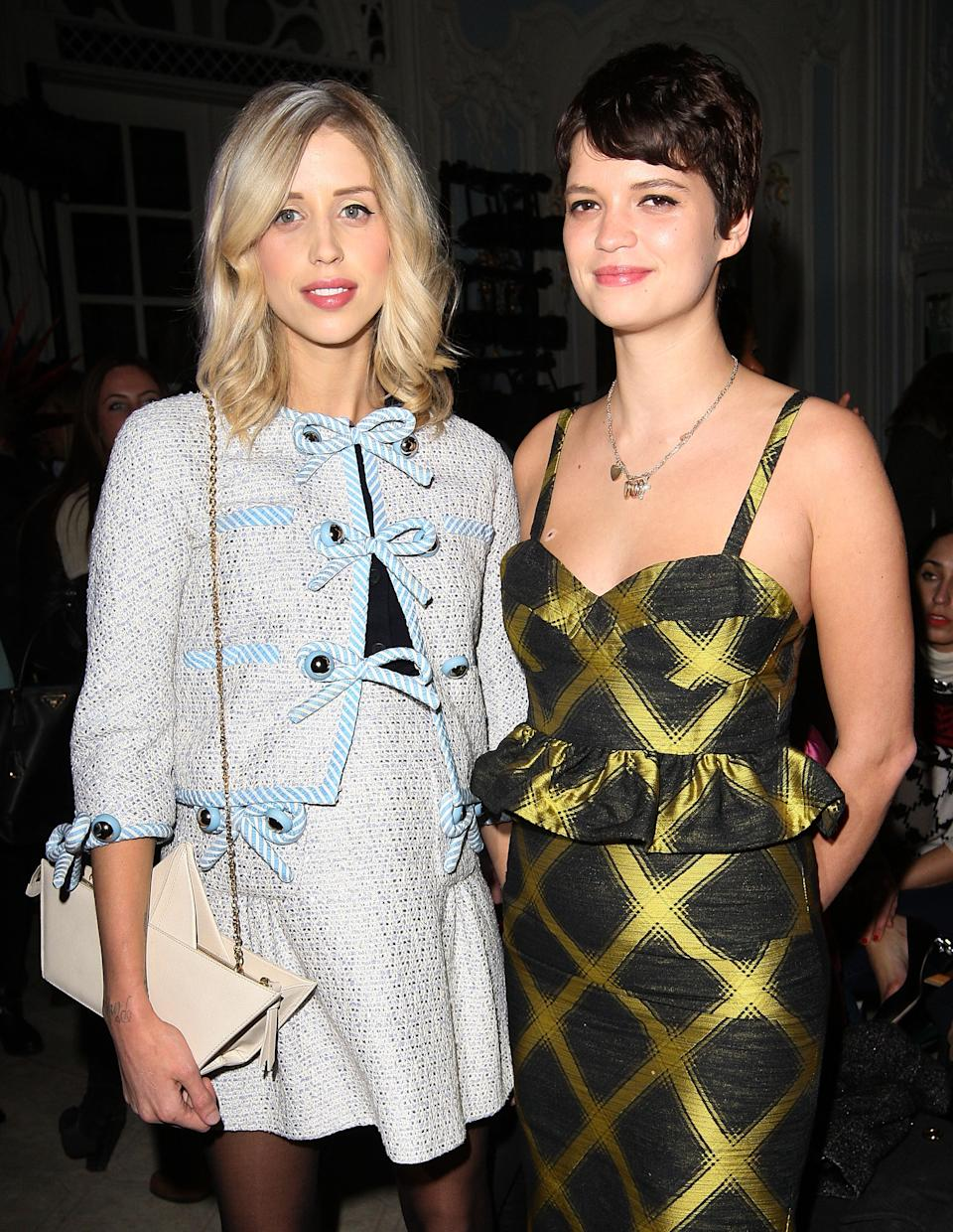 LONDON, ENGLAND - FEBRUARY 16:  Peaches Geldof and Pixie Geldof (R) attend the Moschino cheap&chic show during London Fashion Week Fall/Winter 2013/14 at The Savoy Hotel on February 16, 2013 in London, England.  (Photo by Danny Martindale/WireImage)