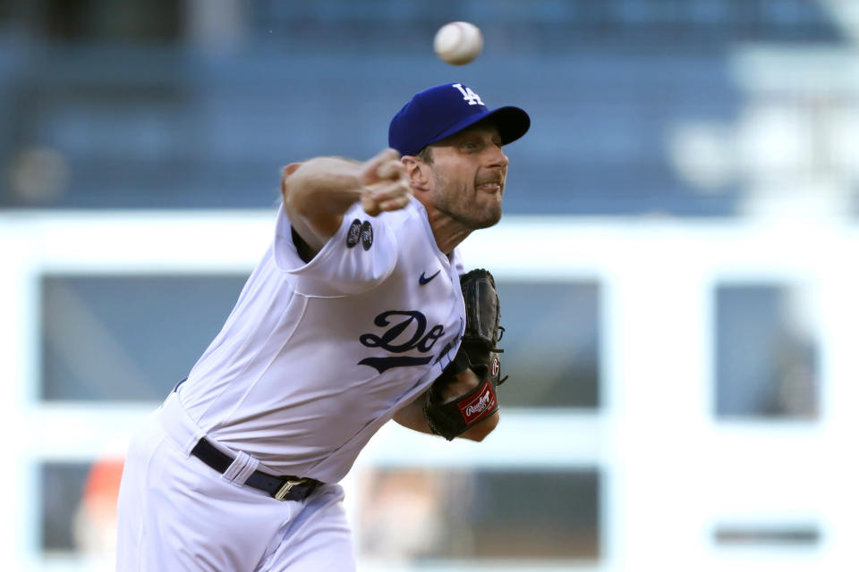 Los Angeles Dodgers starting pitcher Max Scherzer throws to a Houston Astros batter during the first inning of a baseball game in Los Angeles, Wednesday, Aug. 4, 2021. (AP Photo/Alex Gallardo)