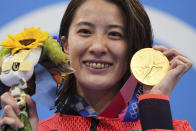 Yui Ohashi of Japan poses with her gold medal for the women's 200-meter individual medley final at the 2020 Summer Olympics, Wednesday, July 28, 2021, in Tokyo, Japan. (AP Photo/Matthias Schrader)