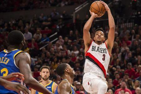 May 20, 2019; Portland, OR, USA; Portland Trail Blazers guard CJ McCollum (3) shoots a basket against Golden State Warriors forward Alfonzo McKinnie (28) during the first half in game four of the Western conference finals of the 2019 NBA Playoffs at Moda Center. Mandatory Credit: Troy Wayrynen-USA TODAY Sports