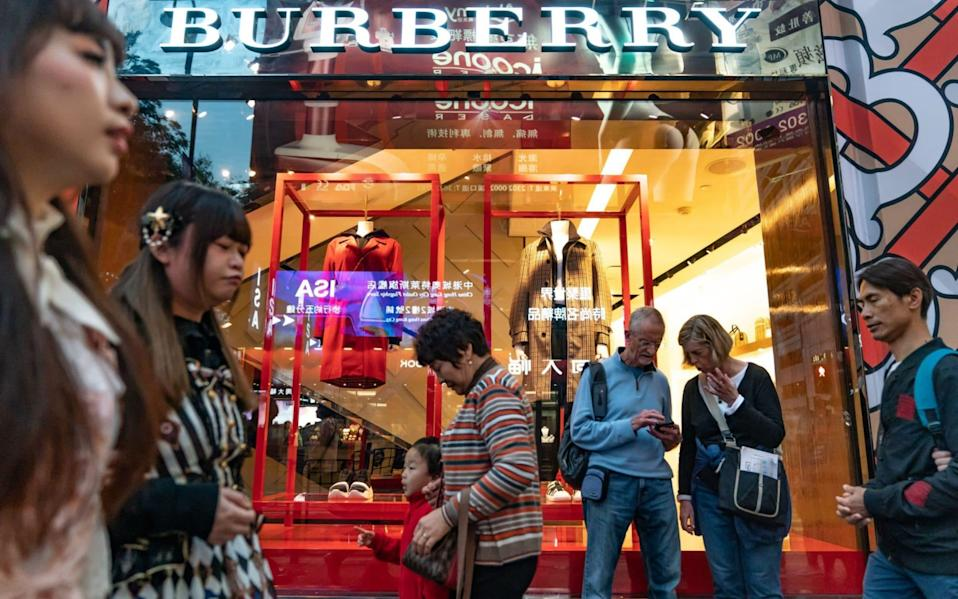 Pedestrians walk past a Burberry Group Plc. store on Canton Road in the Tsim Sha Tsui district of Hong Kong, China - Anthony Kwan/Bloomberg