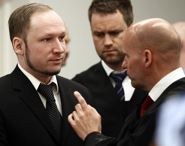 "Defendant Anders Behring Breivik with his lawyers Geir Lippestad right and Odd Ivar Groen during the third day of proceedings in courtroom 250 in the courthouse in Oslo Wednesday April 18, 2012. Confessed mass killer Breivik on Wednesday called Norway's prison terms ""pathetic"" and said the death penalty or an acquittal were the ""only logical outcomes"" for his massacre of 77 people. (AP Photo/ Lise Aserud, Pool)"