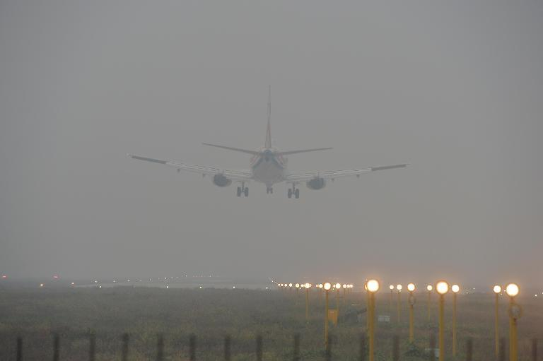 An airplane takes off from an airport in Beijing amid heavy smog on October 9, 2014