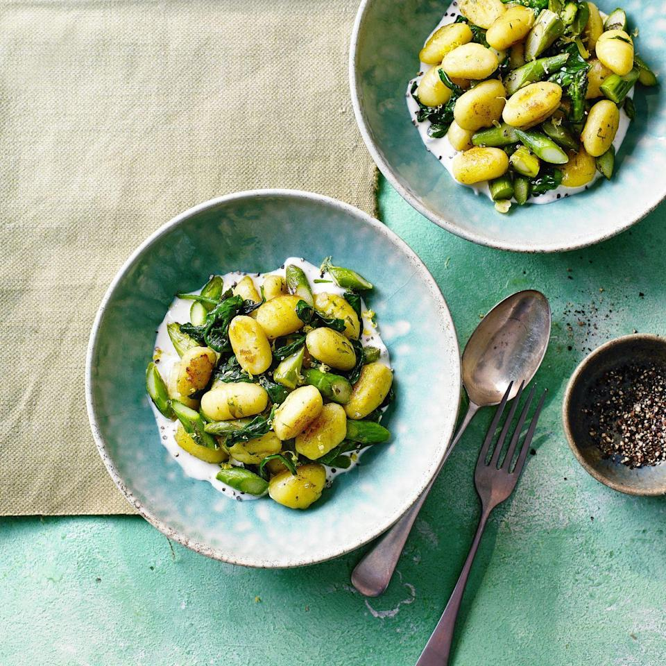 """<p>Serving the gnocchi and asparagus on top of the sauce helps to keep the gnocchi crispy</p><p><strong>Recipe: <a href=""""https://www.goodhousekeeping.com/uk/food/recipes/a35779757/crispy-spring-gnocchi/"""" rel=""""nofollow noopener"""" target=""""_blank"""" data-ylk=""""slk:Crispy Spring Gnocchi"""" class=""""link rapid-noclick-resp"""">Crispy Spring Gnocchi</a></strong></p>"""