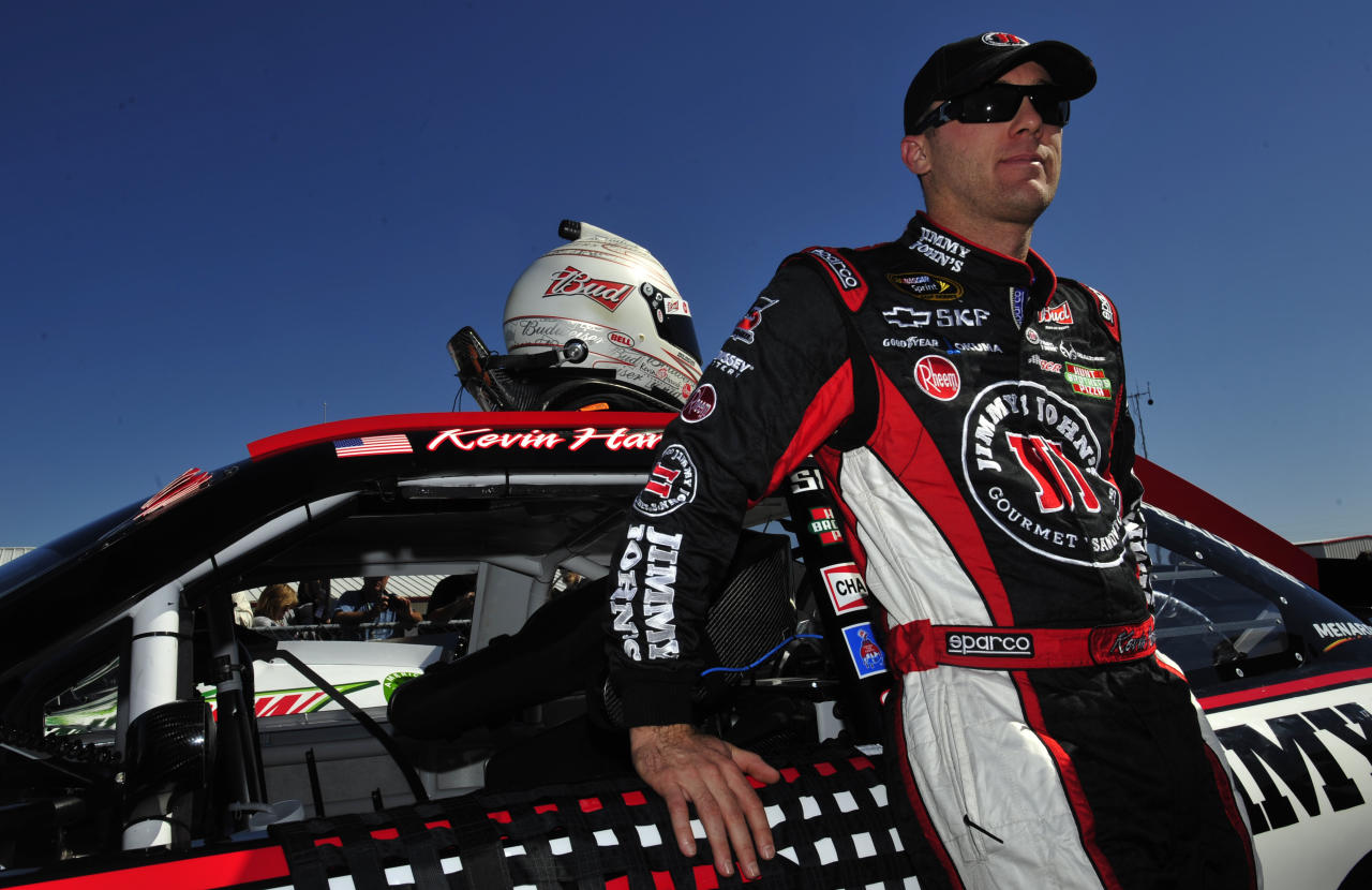 NASCAR Sprint Cup Series driver Kevin Harvick (29) leans on his car after qualifying for the Good Sam Club 500 auto race at the Talladega Superspeedway Saturday, Oct. 22, 2011, in Talladega, Ala. (AP Photo/Rainier Ehrhardt)