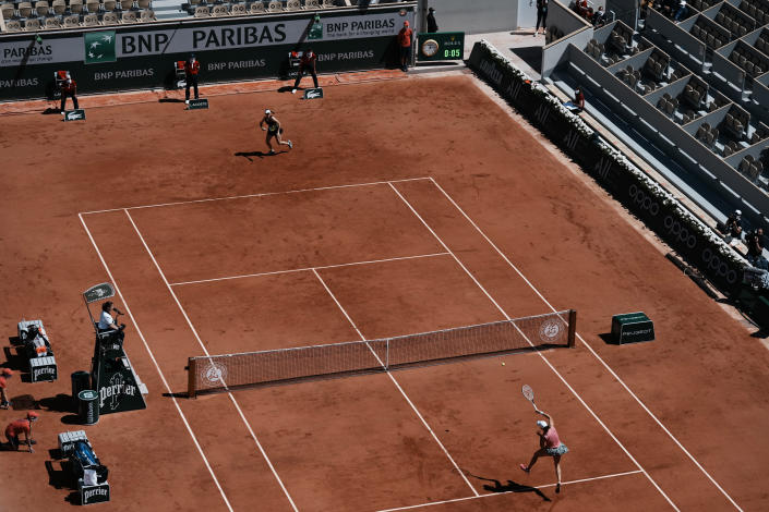 Poland's Iga Swiatek, right, plays a return to Slovenia's Kaja Juvan during their first round match on day two of the French Open tennis tournament at Roland Garros in Paris, France, Monday, May 31, 2021. (AP Photo/Thibault Camus)