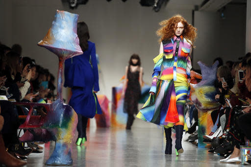 <p>A model wears a creation by designer Fydor Golan during the runway show as part of London Fashion Week, Friday, Feb. 17, 2017. (AP Photo/Alastair Grant) </p>