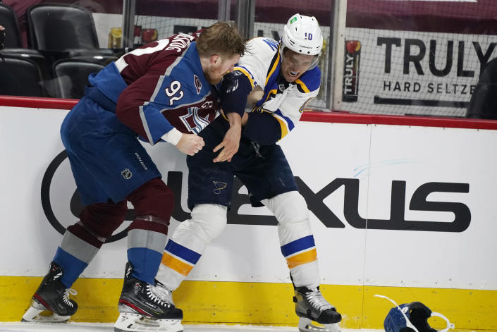 Colorado Avalanche left wing Gabriel Landeskog, left, fights with St. Louis Blues center Brayden Schenn in the first period of Game 1 of an NHL hockey Stanley Cup first-round playoff series Monday, May 17, 2021, in Denver. (AP Photo/David Zalubowski)