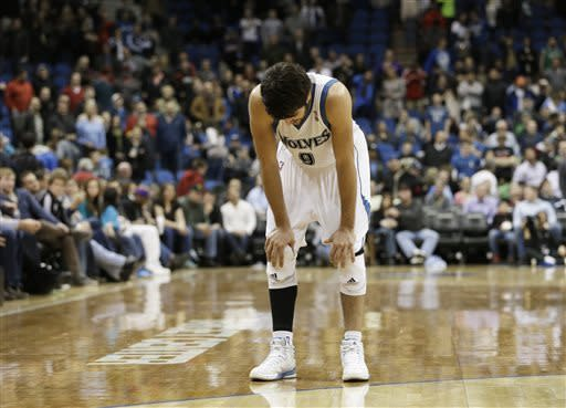 Minnesota Timberwolves' Ricky Rubio, of Spain slumps, in dejection after missing a free throw that would have tied the NBA basketball game against the Toronto Raptors with less than two seconds left, Friday, April 5, 2013, in Minneapolis. The Raptors won 95-93. Rubio had 13 points and 12 assists. (AP Photo/Jim Mone)