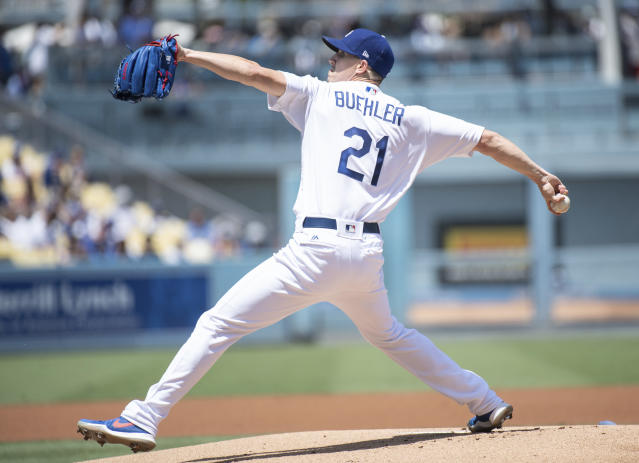 Los Angeles Dodgers starting pitcher Walker Buehler delivers a pitch during the first inning of a baseball game against the Houston Astros in Los Angeles, Sunday, Aug. 5, 2018. (AP Photo/Kyusung Gong)