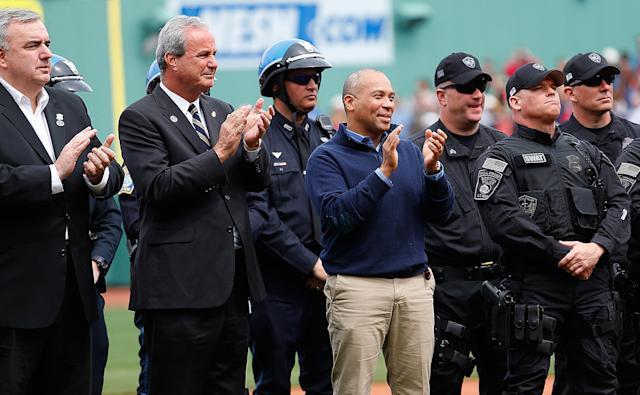 BOSTON, MA - APRIL 20: Governor Deval Patrick, of Massachusetts, applauds after the singing of the National Anthem during a pre-game ceremony in honor of the bombings of Marathon Monday before a game at Fenway Park on April 20, 2013 in Boston, Massachusetts. (Photo by Jim Rogash/Getty Images)