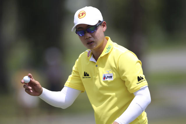 Jazz Janewattananond of Thailand acknowledges the crowd on the 18th hole at the Malaysia Golf Championship 3rd round in Kuala Lumpur, Malaysia, Saturday, March 23, 2019. (AP Photo/Vincent Phoon)