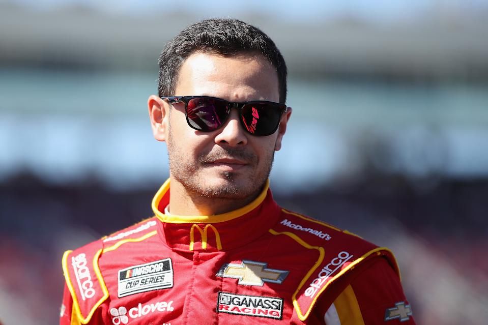 Kyle Larson wearing sunglasses and looking ahead.