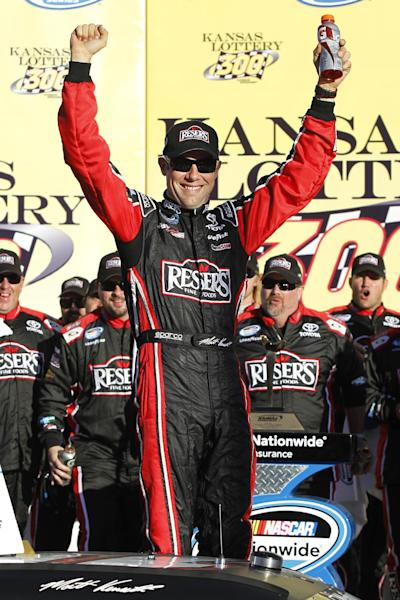Matt Kenseth celebrates his victory in the NASCAR Nationwide Series auto race at Kansas Speedway in Kansas City, Kan., Saturday, Oct. 5, 2013. (AP Photo/Colin E. Braley)
