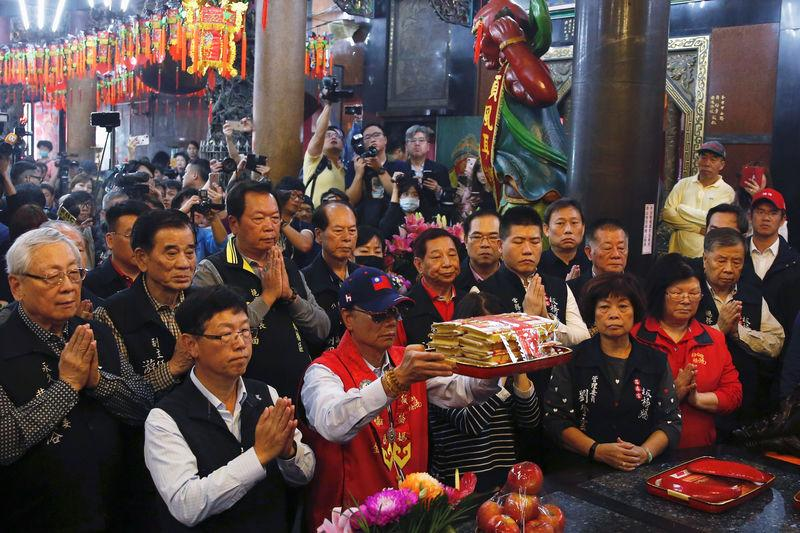 Terry Gou, founder and chairman of Foxconn, prays at a temple, in New Taipei City