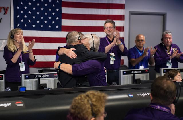 "<p>Cassini program manager at JPL, Earl Maize, left, and spacecraft operations team manager for the Cassini mission at Saturn, Julie Webster embrace after the Cassini spacecraft plunged into Saturn, Friday, Sept. 15, 2017 at NASA's Jet Propulsion Laboratory in Pasadena, Calif. Since its arrival in 2004, the Cassini-Huygens mission has been a discovery machine, revolutionizing our knowledge of the Saturn system and captivating us with data and images never before obtained with such detail and clarity. On Sept. 15, 2017, operators deliberately plunged the spacecraft into Saturn, as Cassini gathered science until the end. The ""plunge"" ensures Saturn's moons will remain pristine for future exploration. During Cassini's final days, mission team members from all around the world gathered at NASA's Jet Propulsion Laboratory, Pasadena, Calif., to celebrate the achievements of this historic mission. (Photo: NASA/Joel Kowsky) </p>"