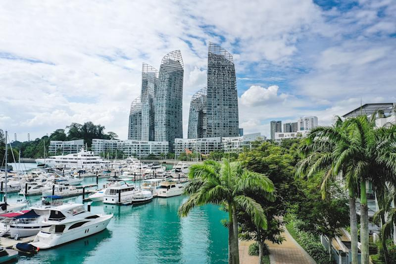 Modern and luxury smart homes in Singapore, seen from above during a hot summer day at the Keppel Bay Yacht Marina area in the city centre.