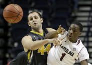 Missouri forward Ryan Rosburg (44) passes the ball against South Carolina guard Marcus Stroman (1) during the second half of an NCAA college basketball game in the first round of the Southeastern Conference tournament, Wednesday, March 11, 2015, in Nashville, Tenn. South Carolina won 63-54. (AP Photo/Mark Humphrey)