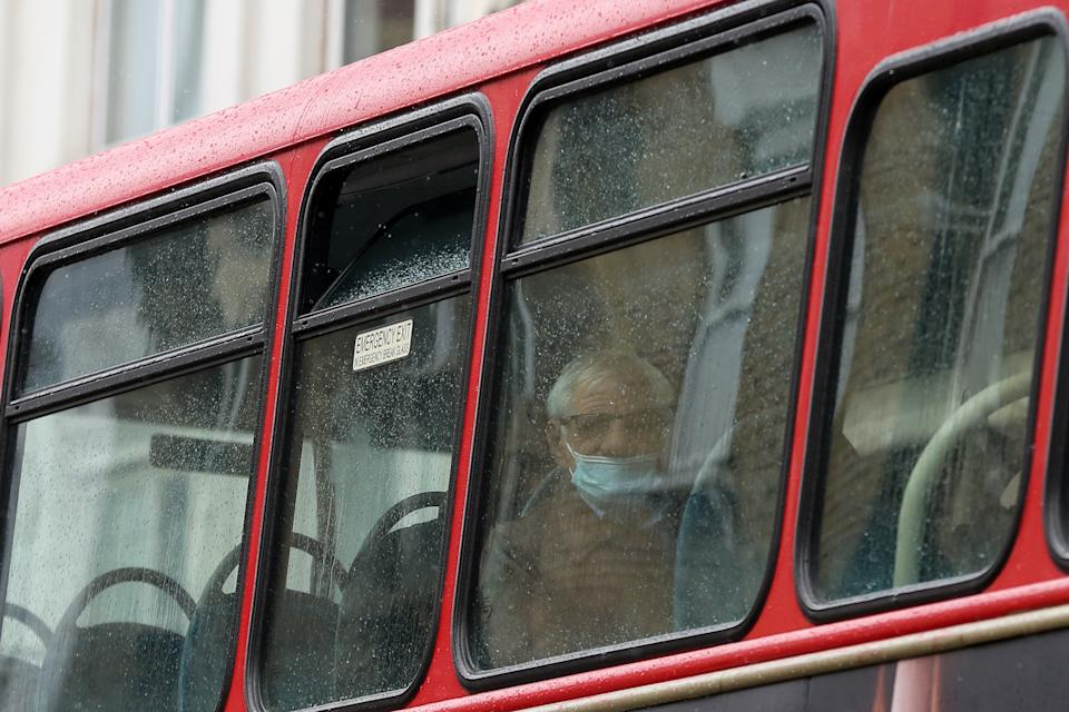 LONDON, UNITED KINGDOM - 2021/05/13: A man wearing a face mask travels on a bus in London. (Photo by Dinendra Haria/SOPA Images/LightRocket via Getty Images)