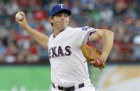 Texas Rangers starting pitcher Nick Tepesch throws in the first inning of a baseball game against the Chicago White Sox in Arlington, Texas, Wednesday, May 1, 2013. (AP Photo/Brandon Wade)